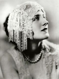 Norma Shearer 1925...the hats were so amazing,,,,,can see where the hippies got their ideas in the 60s!