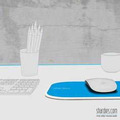 A blue 'shardies' mouse pad energizes your work space and refreshes your tired eyes.