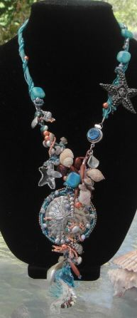 "By Sheryl Stephens/Cool Moon Creations:  ""Stars of the Sea"" Necklace-Sterling, Pewter, glass, crystal, goldstone, rose quartz, real shell, freshwater & glass pearl, organza ribbon and a ton of seed beads...."
