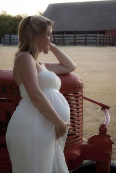 awww...Love!! With my Papa's tractor of course : )