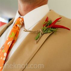 The groomsmen wore fun boutonnieres of chili peppers and sprigs of rosemary wrapped with twine.
