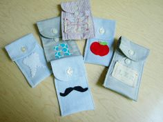 Appliquéd Shirt Cuff Pouches- absolutely darling! You make them out of the cuffs of men's shirts. They work like little wallets! Customize them to fit your child, and voila!
