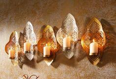 Artikeldetails:  Dekorativer Kerzenhalter für 5 Lichter, Zur Befestigung an der Wand, Maße (B/T/H): 81/9,5/36 cm,  Material/Qualität:   Aus Metall,  ...