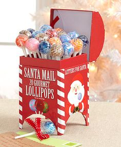 Set out this Gourmet Lollipops in Holiday Box at your Christmas party for a sweet treat everyone will love. The flavorful suckers come in a festive conta Tabletop Christmas Tree, 1st Christmas, Christmas Decorations, Christmas Ideas, Christmas Wrapping, Funny Christmas, Christmas Projects, Christmas Stocking, Christmas Ornaments