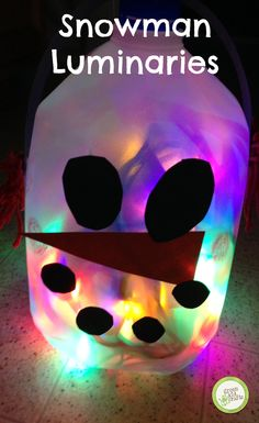 Snowman luminaries to make any walkway festive! http://www.greenkidcrafts.com/milk-jug-snowman/