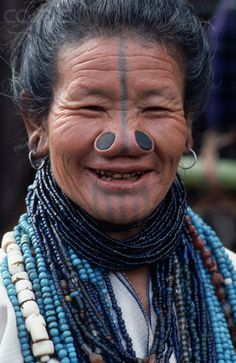 India   Apatani Woman with traditional facial tattoos and nose plugs   © Tiziana and Gianni Baldizzone/Corbis   The Apatani, or Tanii, are a tribal group of people living in the Ziro valley of Arunachal Pradesh