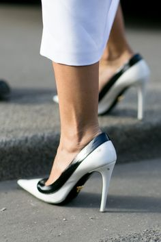 Black and white pumps for the ultimate classic look. Paris Fashion Week via IMAXTREE