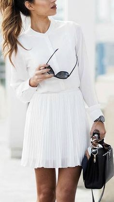 white shirt and a pleated white skirt