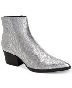 Calvin Klein Women's Narice Varnished Boots $179.00 Calvin Klein's Narice ankle booties are a striking accent that mixes textures and a sleek pointed-toe design with metallic hardware.