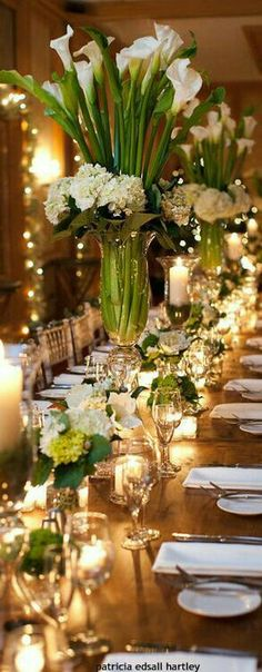 Tall calla Lilly centerpieces for long wedding table Calla Lily Centerpieces, Party Table Centerpieces, Tall Wedding Centerpieces, Wedding Arrangements, Floral Arrangements, Wedding Decorations, Table Decorations, Tall Centerpiece, Tall Vases
