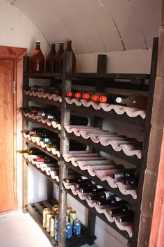 www.vilikkala.fi #Kotisäkki Reusing the old roof tiles as shelves for bottles in the cellar. Chalk walls.