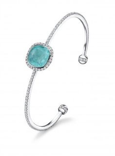 "Exquisite Paraiba Tourmaline and diamond ""thread"" cuff, by Tamir."