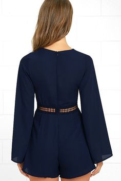 Everything becomes possible the moment you slip into the Wyldr Hope So Navy Blue Romper! Sleek woven poly forms a darted bodice with a V-neckline and long, bell sleeves. Sheer crochet lace accents the waistline above fluttering shorts. Hidden back zipper.