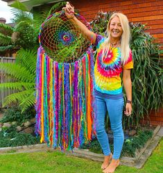 Handmade rainbow dream catcher Available in 30cm hoop 35cm hoop 40cm hoop 45cm hoop (For 50cm, 55cm and 65cm hoops send me a message and i will make a listing for you) Measurements are hoop size and the tails are always long Handmade with love in Sydney Australia CRUELTY FREE (no