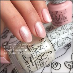 OPI Kitty White over OPI Small + Cute = ❤. Visit imabeautygeek.com for full collection swatches, review, and comparisons!