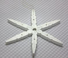 Make a snowflake ornament from clothespins.