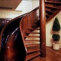 Awesome!!!! This is THE COOLEST thing I have ever seen! My husband has always told me our dream house should incorporate a sprial stair somehow.  But what if??? You could spiral it up and slide it down...that ROCKS!