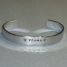 Hey, I found this really awesome Etsy listing at https://www.etsy.com/listing/84127493/vegan-love-hand-stamped-aluminum-cuff