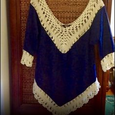 Stunning faux suede and crochet boho chic top! Gorgeous! NWOT- excellent quality- soft faux leather in navy with a v neck and back- detailed with soft cream crochet- 3 qtr sleeves- asymmetrical cut! Love! Tops Blouses