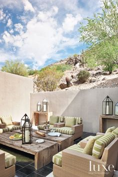 Lyon's outdoor furniture plan is intended to be flexible: Repeating Parsons tables in different sizes can be reconfigured to accommodate small or large groups. Restoration Hardware's all-weather wicker seating is customized with striped cushions in Perennials fabric that stands up to the harsh climate.