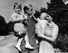 Princess Elizabeth stands with her husband, Prince Philip, and their first two children, Prince Charles and Princess Anne, at Clarence House, the royal couple's London residence. The photo was taken in August 1951.