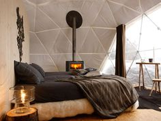 The Whitepod Resort is located Les Cerniers, Switzerland in the heart of the Alps.It is a camp of 15 geodesic dome pods surrounding a central chalet. Each dome is essentially a tent stretched over a wooden structure and platform that allows accommodations out in the beautiful alpine wilderness.    It looks like such a unique, cozy vacation spot