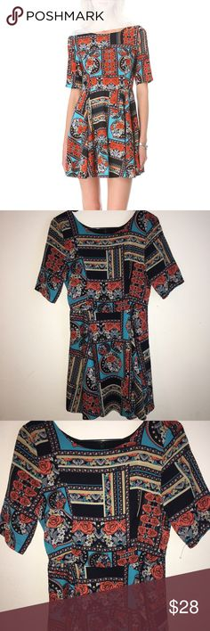 Stunning Women's Small MINKPINK dress Gorgeous dress with rose print all over it, short sleeve and slightly above knee length (give or take depending on the person) size small but it is stretchy. Fit and flare dress style, used but in nearly perfect condition. MINKPINK Dresses