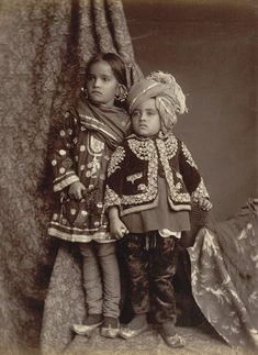 portrait of a young Kashmiri boy and girl. ca. 1890 These elegantly dressed children are wearing clothing embroidered with intricate traditional patterns which are said to have been inspired by the beauty of the flora and fauna of Kashmir. This beautiful area on the northern borders of India and Pakistan is famous for its woolen textiles, fine shawls and carpets which are still produced using traditional methods, going back centuries.