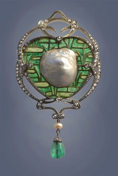 FONSEQUE & OLIVE  An Impressive Belle Epoque Brooch-Pendant   Gold Silver Plique-à-jour enamel Emerald Diamond Pearl  H: 9 cm (3.54 in)  W: 5.25 cm (2.07 in)   Marks: French assay mark & 'FO' monogram.  French, c.1905