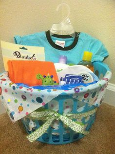 Baby Shower Gift - Mix of practical and fun stuff.    Tips:   Add a gift for the older sibling so they feel included    Include clothes for a few months down the line. New parents will likely be loaded will 0-6 mo. clothes and 9-18 mo. clothes will come in handy.