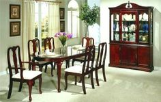 """7pc Queen Anne Style Cherry Finish Dining Table & Chair Set by Poundex. $810.18. 7pc Queen Anne Cherry Dining Table & Chair Set. Dining and Kitchen. Dining and Kitchen->Dining Room Sets->Casual Dining. Some assembly may be required. Please see product details.. You will receive a total of 1 table, 4 side chairs and 2 arm chairs Table Measures: 60-74""""L 40""""W 30""""H Side Chairs Measure: 21""""W 22""""D 39""""H  Arm Chairs Measure: 23""""W 22""""D 39""""H Finish: Cherry Materials: Wood & Fabric 7..."""