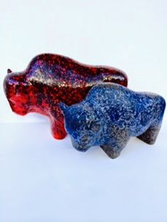 """Created by Ruscha ceramics in the 1960s this pair of Bison are large and magnificent. The red one is almost 17"""" long and it's blue brother i..."""