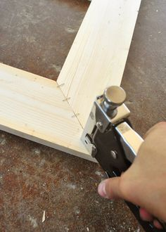 How To Build Picture Frames with Scrap Wood - glue together and staple on the back to keep the joints together.