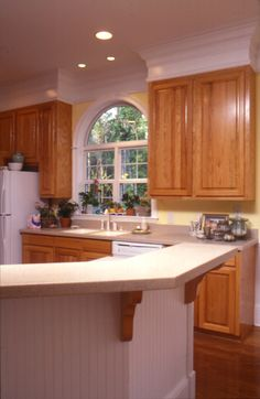 Beautiful rched window above the sink | Plan 024D-0061 | House Plans and More