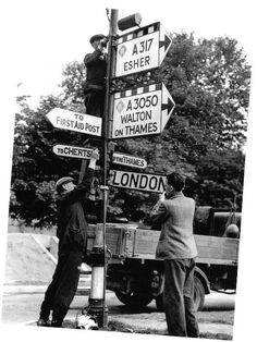 To confuse any invading armies the road signs are changed in London, 1940.