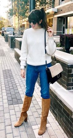 #winter #outfits white sweater, blue jeans, and pair of brown heeled boots