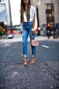 fashion blogger mia mia mine wearing levi's jeans from revolve and schutz tie heels