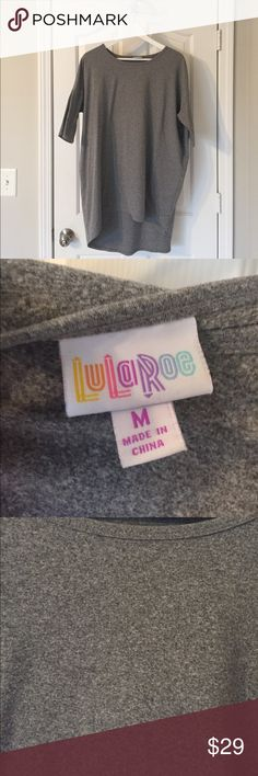 Heather Grey Jersey Lularoe Irma Tunic Size M Classic staple from Lularoe. Carly tunic top is a high low top, covering everything that needs to be covered 😉 Size one size down from your store size. This is a pre-owned item that has been washed and hung dry to LLR standards. The fabric is thicker than the average Irma and feels almost like a light exercise jacket in weight. 92% poly 8% spandex LuLaRoe Tops Tunics