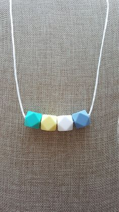 Made of silicone (the same material as teethers), this fashion forward chew-safe bead necklace is great for mom to wear, for her to look great, but baby can enjoy it too! They will love the designs and colors and it won't break when they tug on it. If they put it in their mouths, it is soft on babies gums and emerging teeth, non toxic, and BPA free and mom can pop it in the dishwasher or simply rinse it clean with soap and water to keep it germ free. Not only are they a great fashion find…