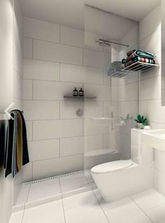 "Large white tiles - Kerry Phelan Design. Similar layout of our small bathroom with a floating sink! Would prefer a glossier finish to the tiles since we won't be tiling all the walls ""wet room."""