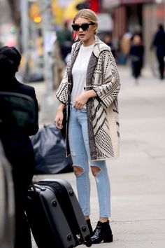 Gigi Hadid looked cozy chic in an oversized sweater and ripped denim.