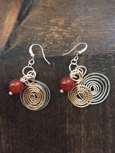 Hammered coiled wire earrings with stone.