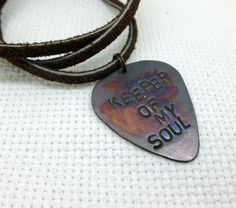 This listing is for a hand stamped copper guitar pick necklace. It is hand stamped with the text of your choosing.. we have many design stamps, so this can be customized by request. The copper is very thick, and not easily manipulated. The necklace is made out of sturdy leather.