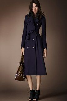 Burberry Prorsum Pre- Autumn/Winter 2014-15. Classic trench coat that is longer that usual causing the women to look slimmer and taller.