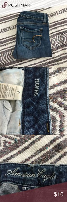 American Eagle jeans size 0 Medium wash (a little on the darker side) one spot is a little frayed (second picture) but other than that these jeans are perfect conditions and very flattering. American Eagle Outfitters Jeans Skinny