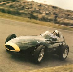 Moss in the Dutch GP winning VW10. Shot shows extreme attention to aero for the day by Frank Costin. Borranis' at front Moss' preference for driver feel but cast alloy wheels adopted in 1958 to save weight. This Vanwall, wi