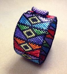 Our PRISM cuff uses beads that capture the illumination of stained glass. Available for peyote as shown or the loom.