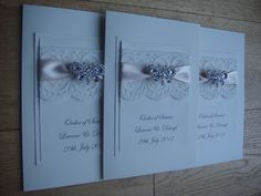 Vintage wedding order of service with lace, satin ribbon and a crystal butterfly embellishment