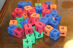 Use the foam counting cubes from the Dollar Tree and write letters on them using a Sharpie- brilliant! (and much quieter than magnetic letters!!!) Put letters together to make words. Sight word practice.