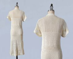 1930s cream crochet dress. Beautifully made with open work yoke and tighter stitches in the midsection and skirt. V neck with adorable folded